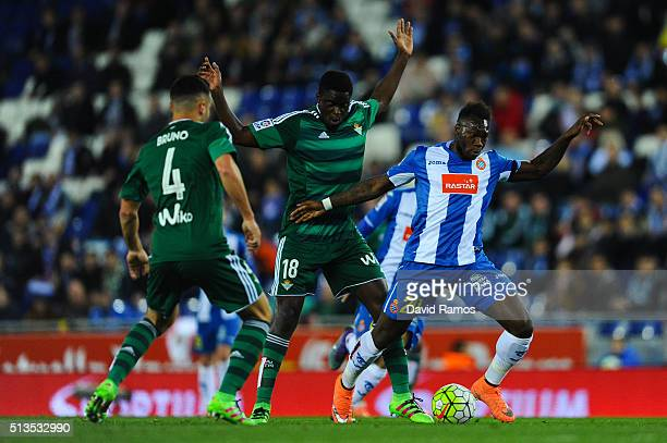 Felipe Caicedo of RCD Espanyol competes for the ball with Alfred N'Diaye of Real Betis Balompie during the La Liga match between Real CD Espanyol and...