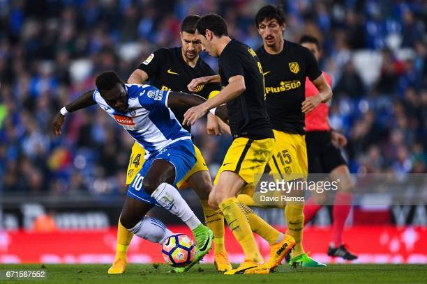 Felipe Caicedo of RCD Espanyol competes for the ball with Gabi Fernandez Diego Godin and Stefan Savic of Club Atletico de Madrid during the La Liga...