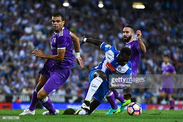 Felipe Caicedo of RCD Espanyol competes for the ball with Pepe and Daniel Carvajal of Real Madrid CF during the La Liga match between RCD Espanyol...
