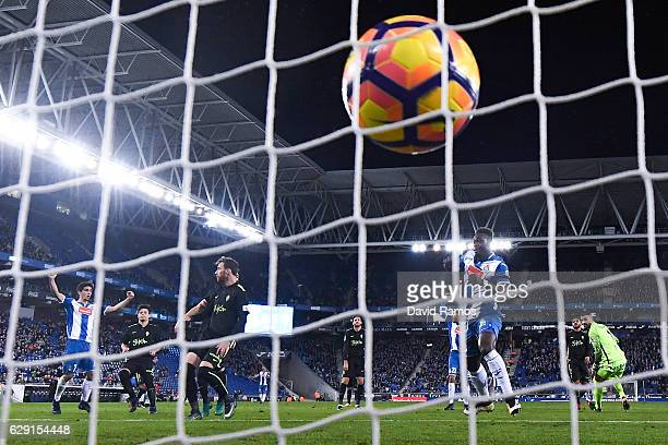 Felipe Caicedo of RCD Espanyol scores the opening goal past Ivan Cuellar of Real Sporting de Gijon during the La Liga match between RCD Espanyol and...