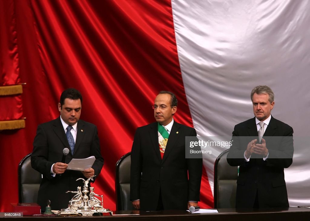 Felipe Calderon Mexico's president center stands with the country's Vice President Cristian Castano left and Senate President Santiago Creel while...