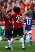 Felipe celebrates the first goal with Lars Stindl of Hannover during the Bundesliga match between Hannover 96 and FC Schalke 04 at AWD Arena on...