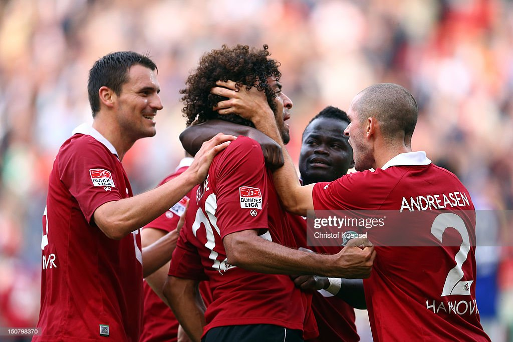 Felipe (2nd L) celebrates the first goal with <a gi-track='captionPersonalityLinkClicked' href=/galleries/search?phrase=Mario+Eggimann&family=editorial&specificpeople=677363 ng-click='$event.stopPropagation()'>Mario Eggimann</a> (L), Didier Ya Konan (2nd R) and <a gi-track='captionPersonalityLinkClicked' href=/galleries/search?phrase=Leon+Andreasen&family=editorial&specificpeople=605829 ng-click='$event.stopPropagation()'>Leon Andreasen</a> (R) of Hannover during the Bundesliga match between Hannover 96 and FC Schalke 04 at AWD Arena on August 26, 2012 in Hannover, Germany.
