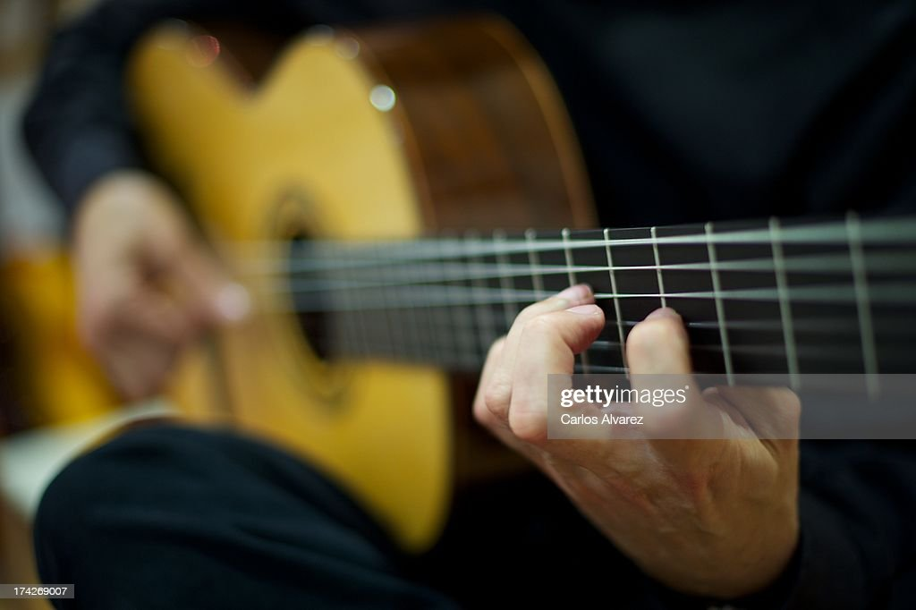 Felipe Conde testing one of his finished guitars on April 3 2013 in Madrid Spain Felipe Conde's family has been handcrafting guitars following the...
