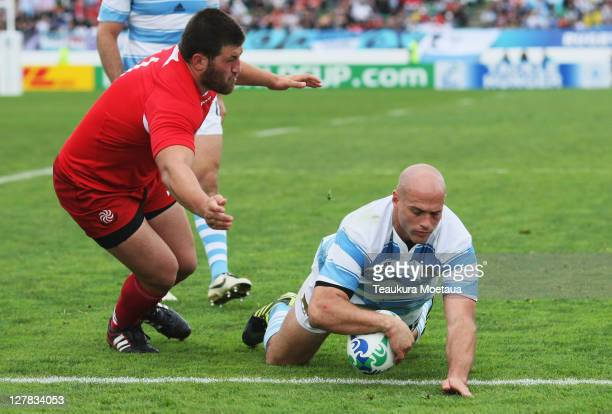 Felipe Contepomi of Argentina goes over to score his teams second try during the IRB 2011 Rugby World Cup Pool B match between Argentina and Georgia...