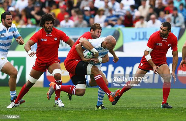 Felipe Contepomi of Argentina is tackled by Giorgi Chkhaidze of Georgia during the IRB 2011 Rugby World Cup Pool B match between Argentina and...