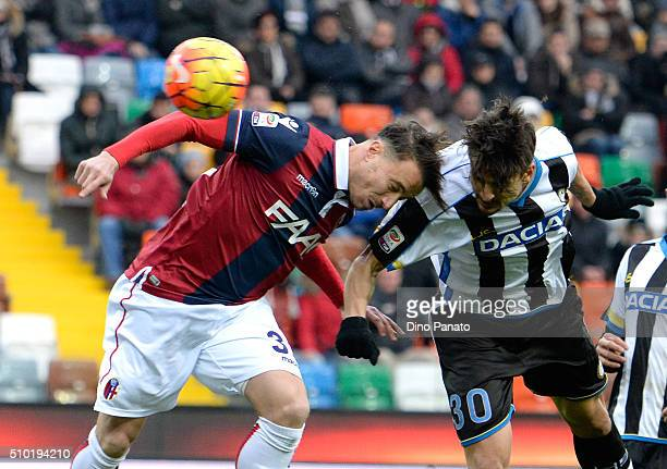 Felipe Dal Bello of Udinese Calcio competes with Archimede Morleo of Bologna FC during the Serie A match between Udinese Calcio and Bologna FC at...