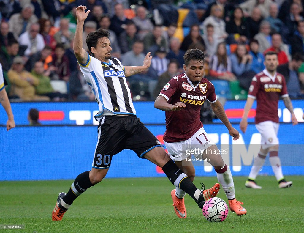 Felipe Dal Bello (L) of Udinese Calcio competes with Josef Martinez of Torino FC during the Serie A match between Udinese Calcio and Torino FC at Dacia Arena on April 30, 2016 in Udine, Italy.