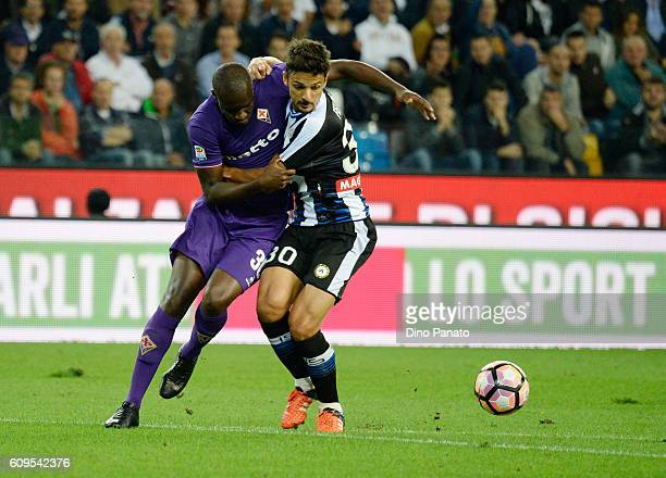 Felipe Dal Bello of Udinese Calcio competes with Khouma Babacar of ACF Fiorentina during the Serie A match between Udinese Calcio and ACF Fiorentina...