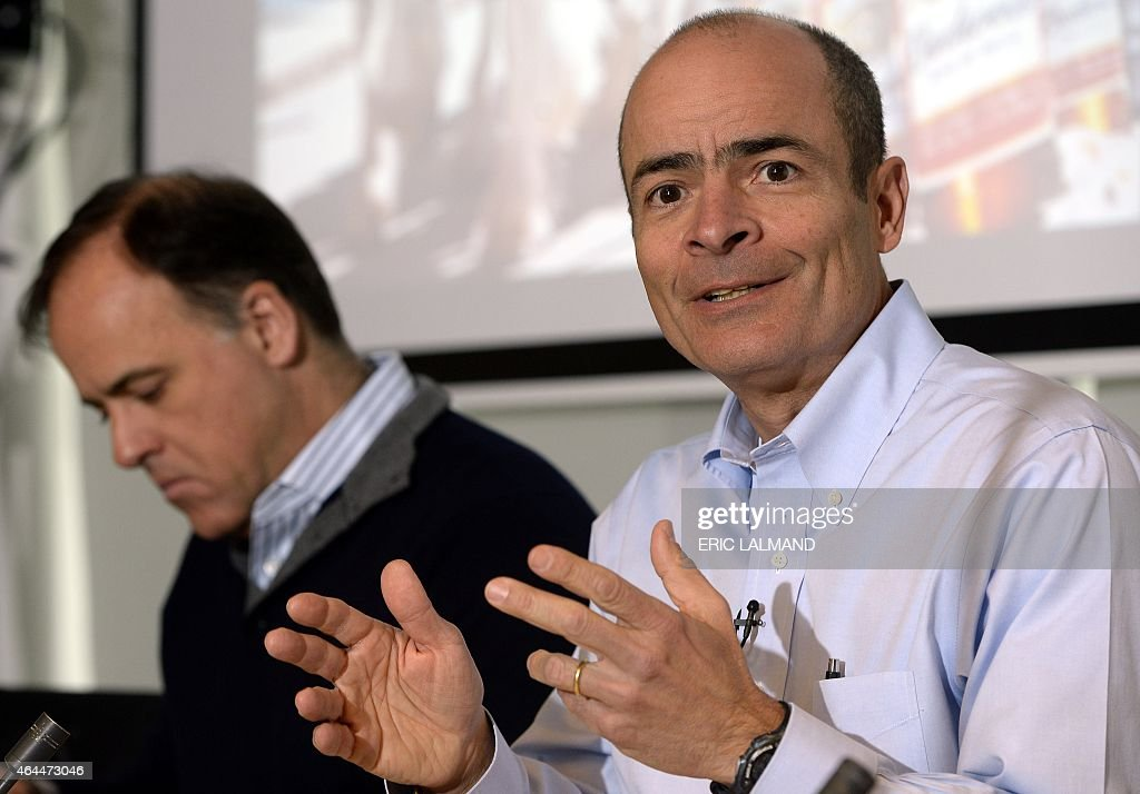 Felipe Dutra (L), CFO of AB Inbev and <a gi-track='captionPersonalityLinkClicked' href=/galleries/search?phrase=Carlos+Brito&family=editorial&specificpeople=5398616 ng-click='$event.stopPropagation()'>Carlos Brito</a> (R), CEO of AB Inbev give a press conference on the 2014 year results of brewery group Anheuser-Busch InBev, in Leuven, on February 26, 2015. AFP PHOTO / BELGA / ERIC LALMAND ==Belgium Out==