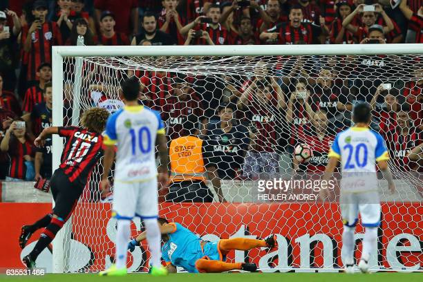 Felipe Gedoz of Brazil's Atletico Paranaense celebrates the second goal he scored against Paraguay's Deportivo Capiata during their Libertadores Cup...