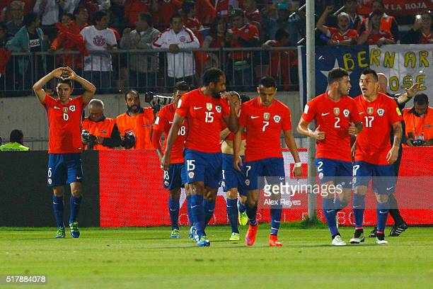 Felipe Gutierrez of Chile celebrates with teammates after scoring the first goal during a match between Chile and Argentina as part of FIFA 2018...