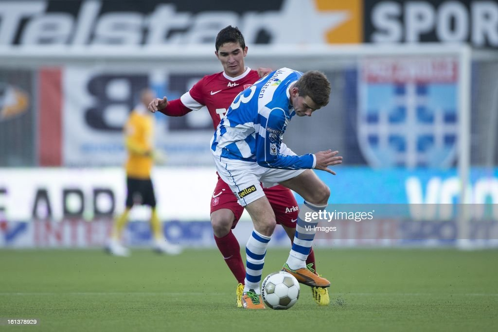 Felipe Gutierrez of FC Twente, Wiljan Pluim of PEC Zwolle during the Dutch Eredivisie match between PEC Zwolle and FC Twente at the IJsseldelta Stadium on february 10, 2013 in Zwolle, The Netherlands