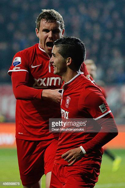 Felipe Gutierrez of Twente celebrates with teammate Andreas Bjelland after scoring the opening goal during the Eredivisie match between FC Twente and...