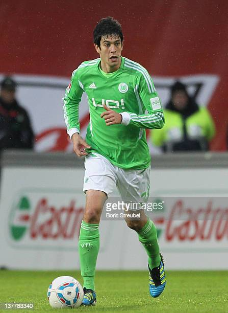 Felipe Lopes of Wolfsburg runs with the ball during the Bundesliga match between VfL Wolfsburg and 1 FC Koeln at Volkswagen Arena on January 21 2012...