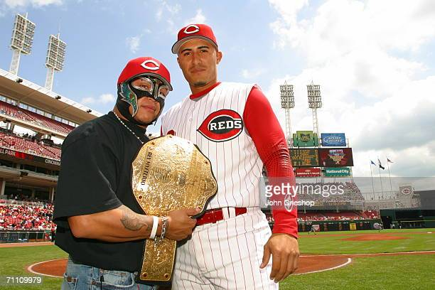 Felipe Lopez of the Cincinnati Reds and Rey Mysterio of the WWE stand on the field prior to the game between the Cincinnati Reds and the St Louis...