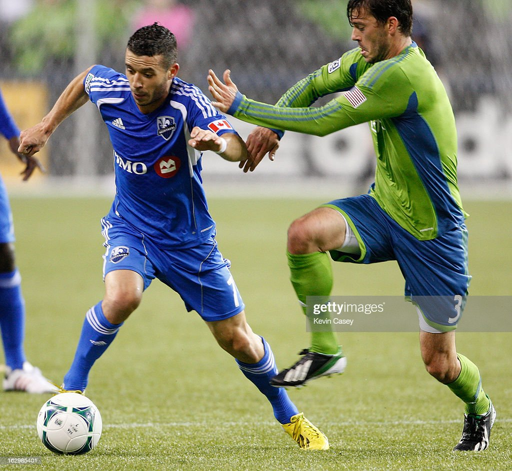Felipe Martins #7 of Montreal Impact dribbles past Brad Evans #3 of the Seattle Sounders in the first half at CenturyLink Field on March 2, 2013 in Seattle, Washington.