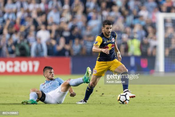 Felipe Martins of New York Red Bulls controls the ball past Ilie Sanchez of Sporting Kansas City in the US Open Cup Final match at Children's Mercy...