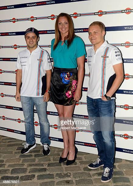 Felipe Massa Melani Costa and Valteri Bottas attend the 'Martini Racing' inauguration on May 7 2014 in Barcelona Spain
