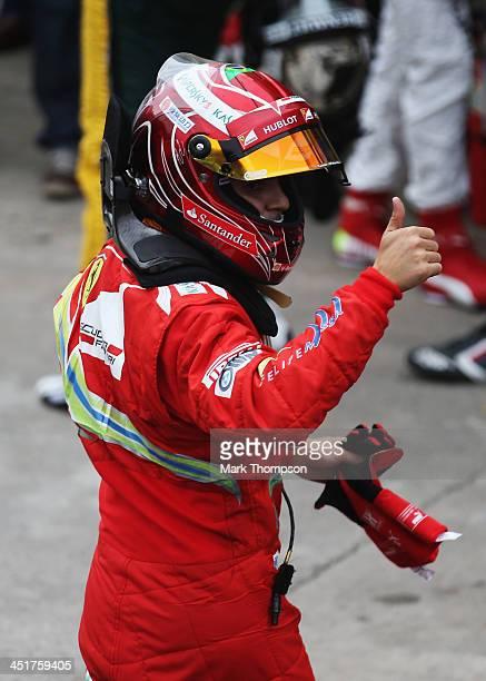 Felipe Massa of Brazil and Ferrari celebrates as he finishes his last race for Ferrari following the Brazilian Formula One Grand Prix at Autodromo...