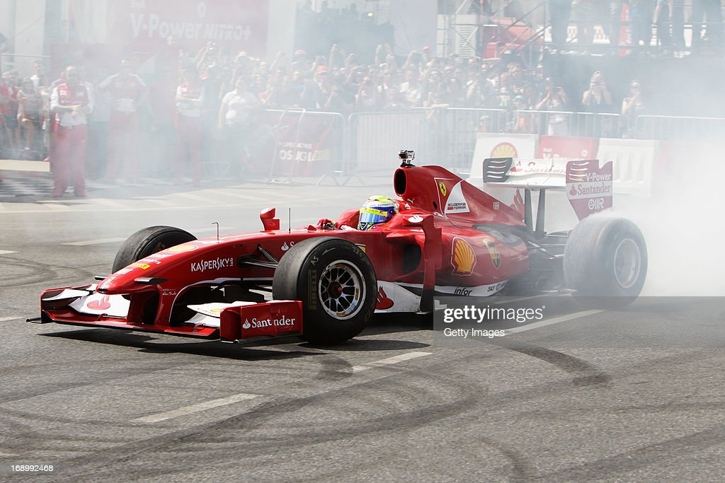 Felipe Massa of Brazil and Ferrari drives in a demonstration run while taking part in the Shell V-Power Nitro+ Show on May 18, 2013 in Warsaw, Poland.