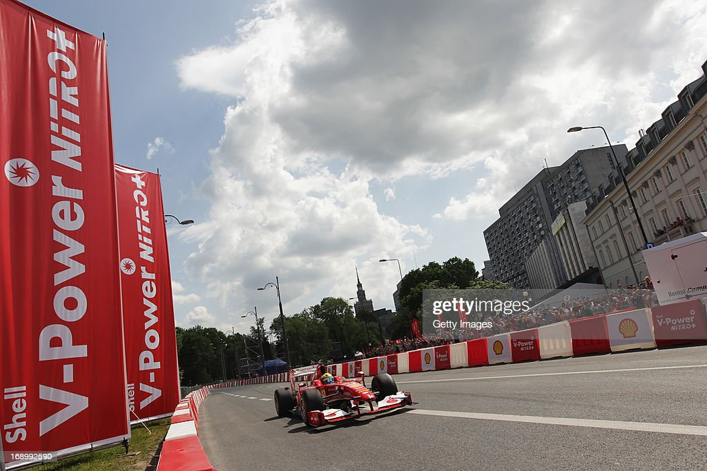 <a gi-track='captionPersonalityLinkClicked' href=/galleries/search?phrase=Felipe+Massa&family=editorial&specificpeople=206660 ng-click='$event.stopPropagation()'>Felipe Massa</a> of Brazil and Ferrari drives in a demonstration run while taking part in the Shell V-Power Nitro+ Show on May 18, 2013 in Warsaw, Poland.
