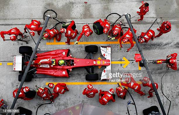 Felipe Massa of Brazil and Ferrari drives in for a pitstop during the Malaysian Formula One Grand Prix at the Sepang Circuit on March 25 2012 in...