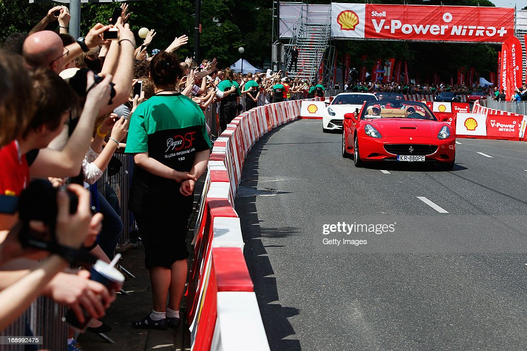 Felipe Massa of Brazil and Ferrari drives with his father Luiz Antonio Massa in a demonstration run while taking part in the Shell V-Power Nitro+ Show on May 18, 2013 in Warsaw, Poland.