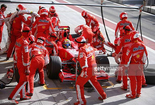 Felipe Massa of Brazil and Ferrari in pit stop action during Formula One testing at the Bahrain International Circuit on February 28 in Sakhir Bahrain