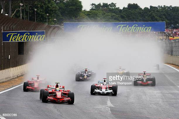Felipe Massa of Brazil and Ferrari leads from Kimi Raikkonen of Finland and Ferrari Jarno Trulli of Italy and Toyota and Lewis Hamilton of Great...