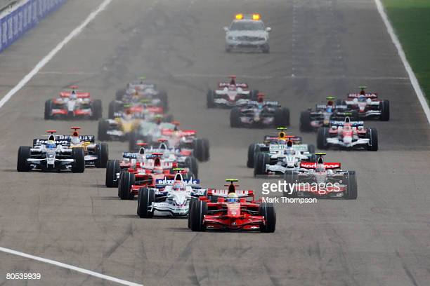 Felipe Massa of Brazil and Ferrari leads the field after overtaking Robert Kubica of Poland and BMW Sauber at the start of the Bahrain Formula One...