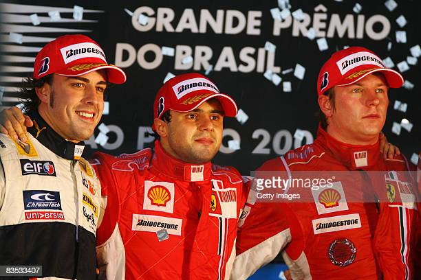 Felipe Massa of Brazil and Ferrari looks disappointed on the podium alongside second placed Fernando Alonso of Spain and Renault and third placed...