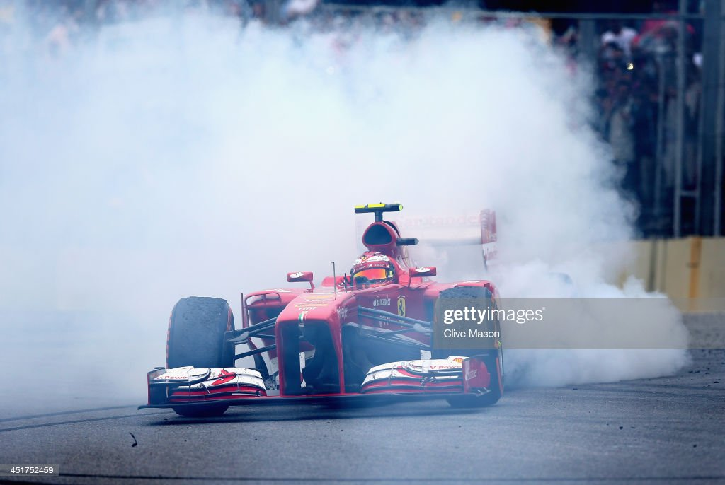 <a gi-track='captionPersonalityLinkClicked' href=/galleries/search?phrase=Felipe+Massa&family=editorial&specificpeople=206660 ng-click='$event.stopPropagation()'>Felipe Massa</a> of Brazil and Ferrari performs donuts as he finishes his last race for Ferrari following the Brazilian Formula One Grand Prix at Autodromo Jose Carlos Pace on November 24, 2013 in Sao Paulo, Brazil.