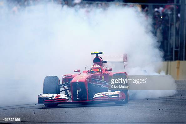 Felipe Massa of Brazil and Ferrari performs donuts as he finishes his last race for Ferrari following the Brazilian Formula One Grand Prix at...