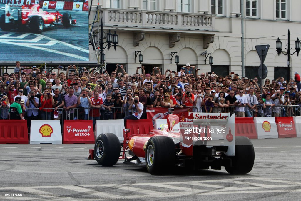 <a gi-track='captionPersonalityLinkClicked' href=/galleries/search?phrase=Felipe+Massa&family=editorial&specificpeople=206660 ng-click='$event.stopPropagation()'>Felipe Massa</a> of Brazil and Ferrari takes part in a demonstration run during the Shell V-Power Nitro+ Show on May 18, 2013 in Warsaw, Poland.