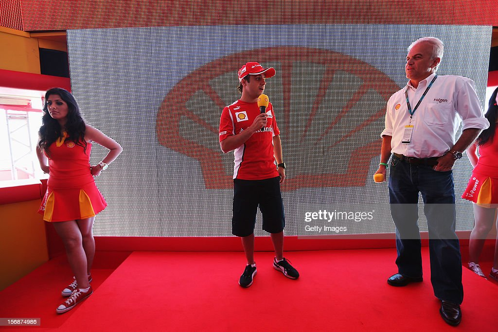 Felipe Massa of Brazil and Ferrari talks to guests in the Shell hospitality suite following practice for the Brazilian Formula One Grand Prix at the Autodromo Jose Carlos Pace on November 23, 2012 in Sao Paulo, Brazil.