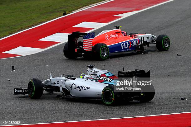 Felipe Massa of Brazil and Williams and Alexander Rossi of the United States and Manor Marussia at the first corner following an earlier collision...