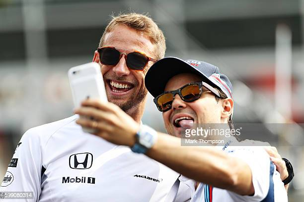 Felipe Massa of Brazil and Williams and Jenson Button of Great Britain and McLaren Honda take a selfie on the drivers parade during the Formula One...