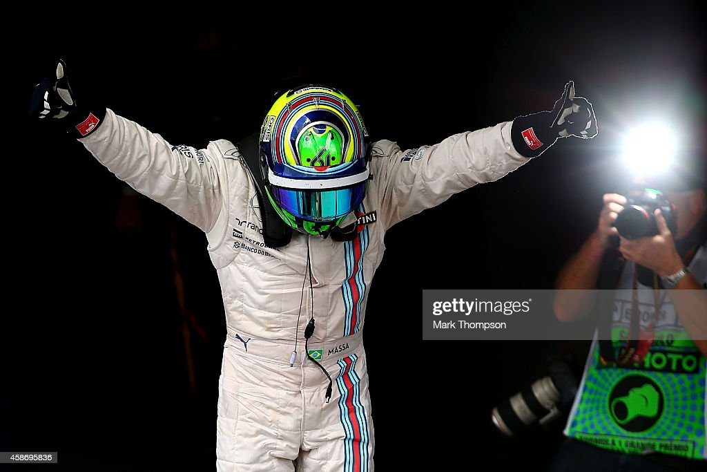 <a gi-track='captionPersonalityLinkClicked' href=/galleries/search?phrase=Felipe+Massa&family=editorial&specificpeople=206660 ng-click='$event.stopPropagation()'>Felipe Massa</a> of Brazil and Williams celebrates in Parc Ferme after finishing third in the Brazilian Formula One Grand Prix at Autodromo Jose Carlos Pace on November 9, 2014 in Sao Paulo, Brazil.