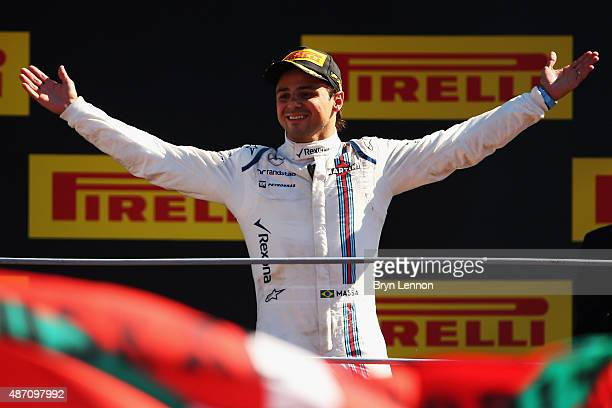 Felipe Massa of Brazil and Williams celebrates on the podium after finishing third in the Formula One Grand Prix of Italy at Autodromo di Monza on...