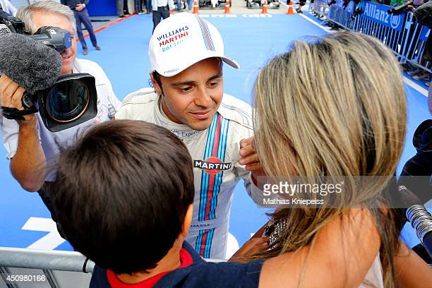 Felipe Massa of Brazil and Williams celebrates with his wife Anna Rafaela Bassi and son Felipinho after claiming pole position during qualifying...