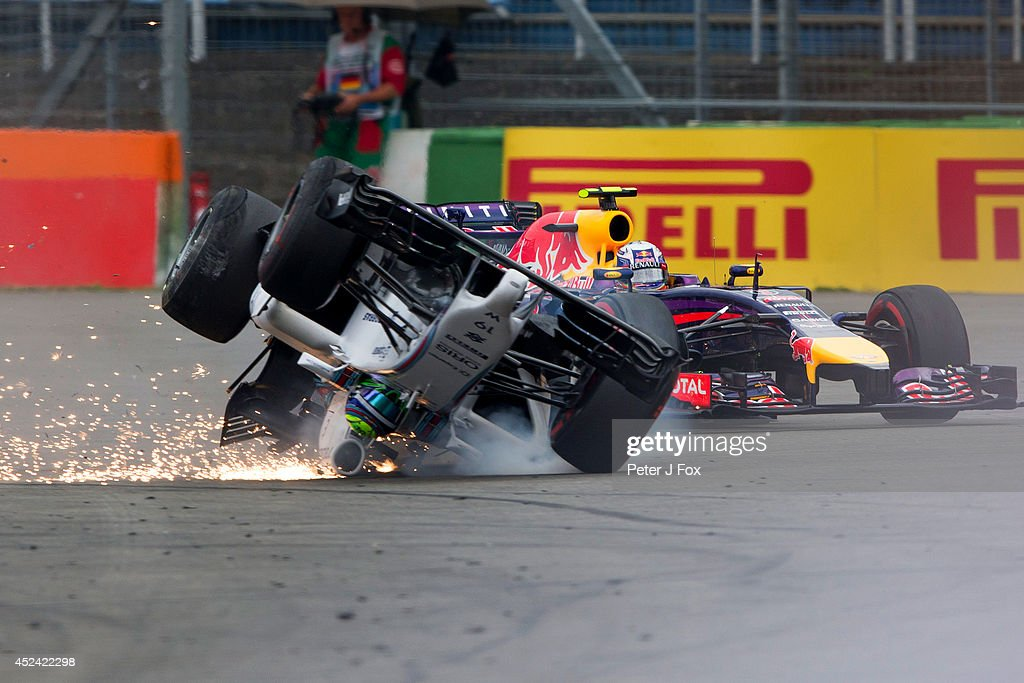 <a gi-track='captionPersonalityLinkClicked' href=/galleries/search?phrase=Felipe+Massa&family=editorial&specificpeople=206660 ng-click='$event.stopPropagation()'>Felipe Massa</a> of Brazil and Williams crashes at the first corner during the German Grand Prix at Hockenheimring on July 20, 2014 in Hockenheim, Germany.