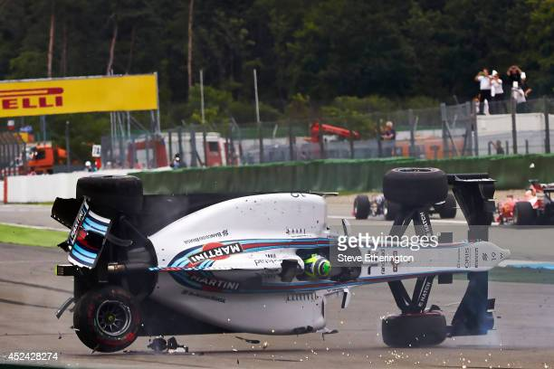 Felipe Massa of Brazil and Williams crashes at the first corner during the German Grand Prix at Hockenheimring on July 20 2014 in Hockenheim Germany