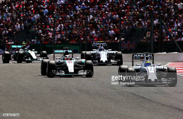 Felipe Massa of Brazil and Williams drives ahead of Lewis Hamilton of Great Britain and Mercedes GP Valtteri Bottas of Finland and Williams and Nico...