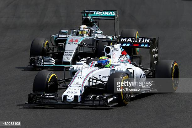 Felipe Massa of Brazil and Williams drives ahead of Lewis Hamilton of Great Britain and Mercedes GP during the Formula One Grand Prix of Hungary at...