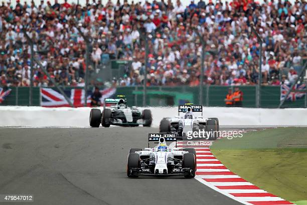 Felipe Massa of Brazil and Williams drives ahead of Valtteri Bottas of Finland and Williams and Nico Rosberg of Germany and Mercedes GP during the...