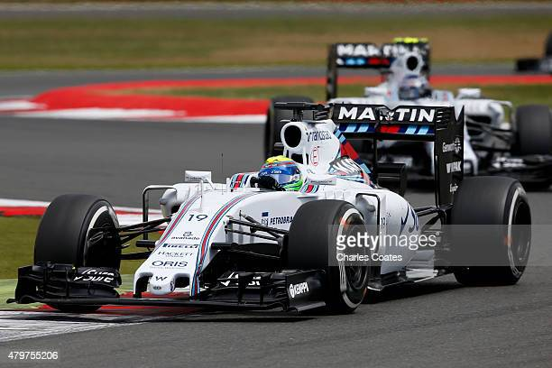 Felipe Massa of Brazil and Williams drives ahead of Valtteri Bottas of Finland and Williams during the Formula One Grand Prix of Great Britain at...