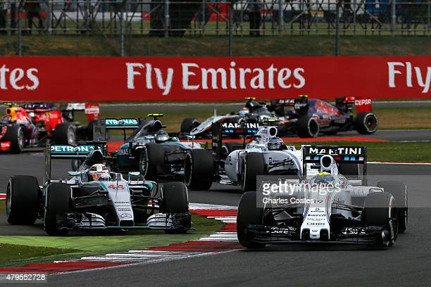 Felipe Massa of Brazil and Williams drives next to Lewis Hamilton of Great Britain and Mercedes GP during the Formula One Grand Prix of Great Britain...