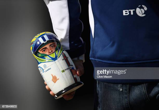Felipe Massa of Brazil and Williams holds a Russian doll with his face one during previews to the Formula One Grand Prix of Russia on April 27 2017...