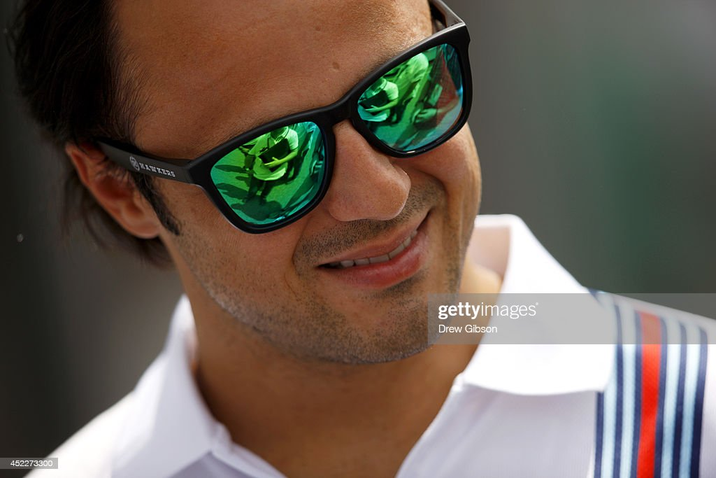 Felipe Massa of Brazil and Williams looks on as he walks around the track with members of his team during previews ahead of the German Grand Prix at Hockenheimring on July 17, 2014 in Hockenheim, Germany.